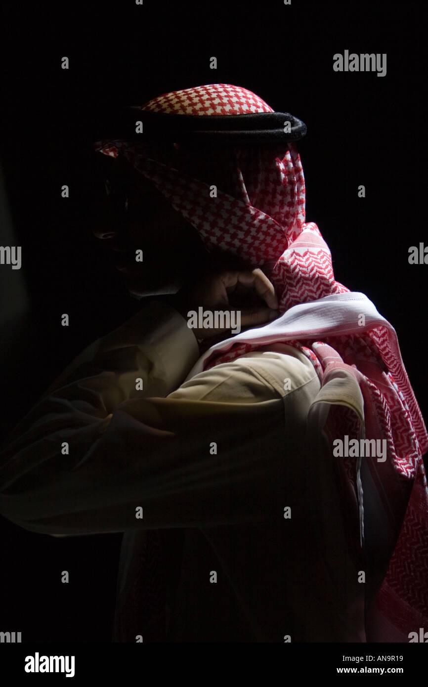 Arab under spotlight in Jeddah Saudi Arabia - Stock Image
