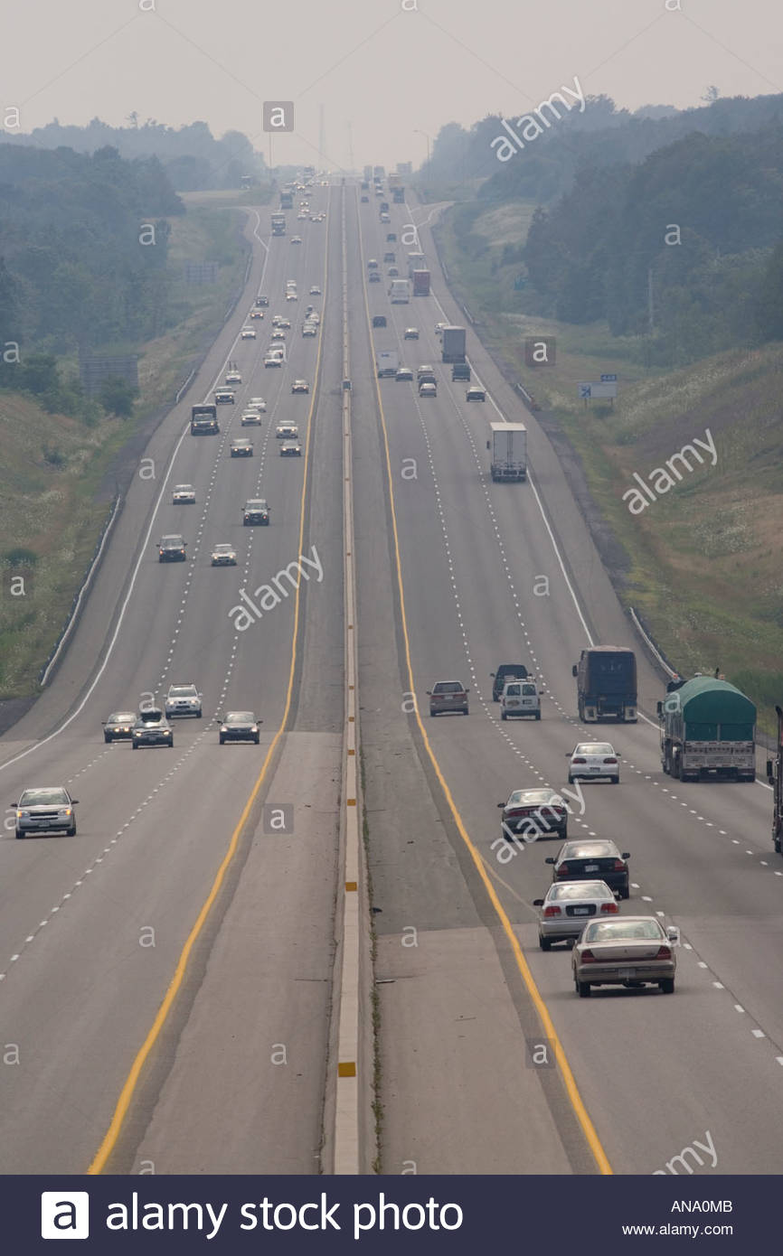 Hot smoggy polluted summer day on Highway 401 near Clarington Ontario Canada - Stock Image