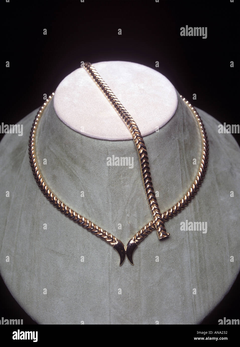 gold necklace on display - Stock Image