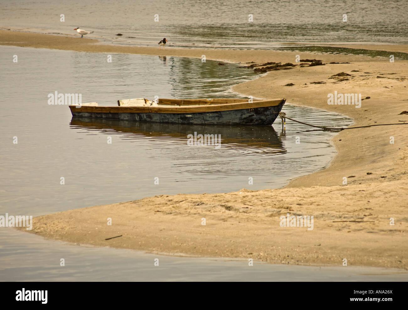 rowboat small boat abandoned sunk founder - Stock Image