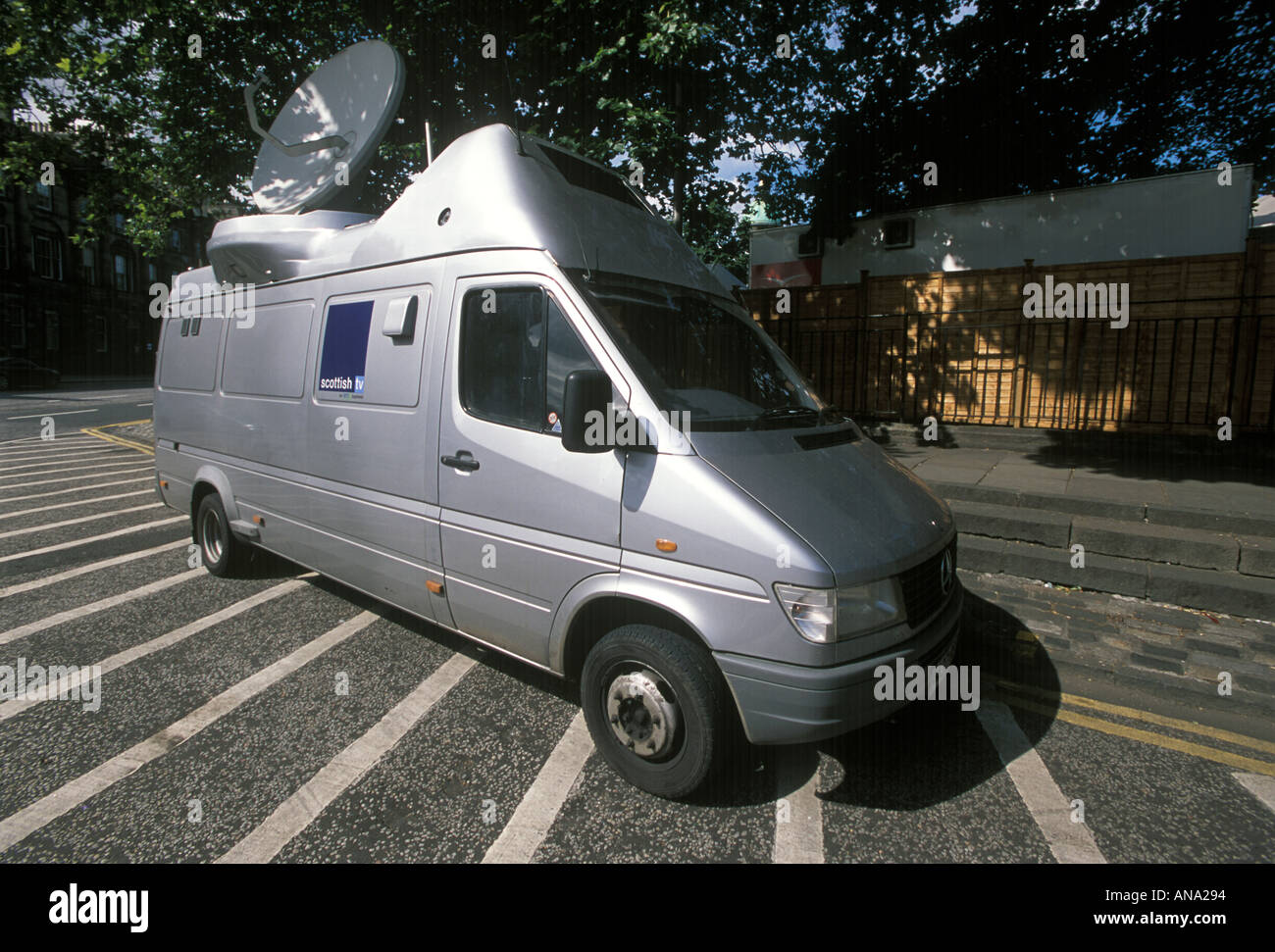 TV van with satellite dish at the Edinburgh Festival - Stock Image