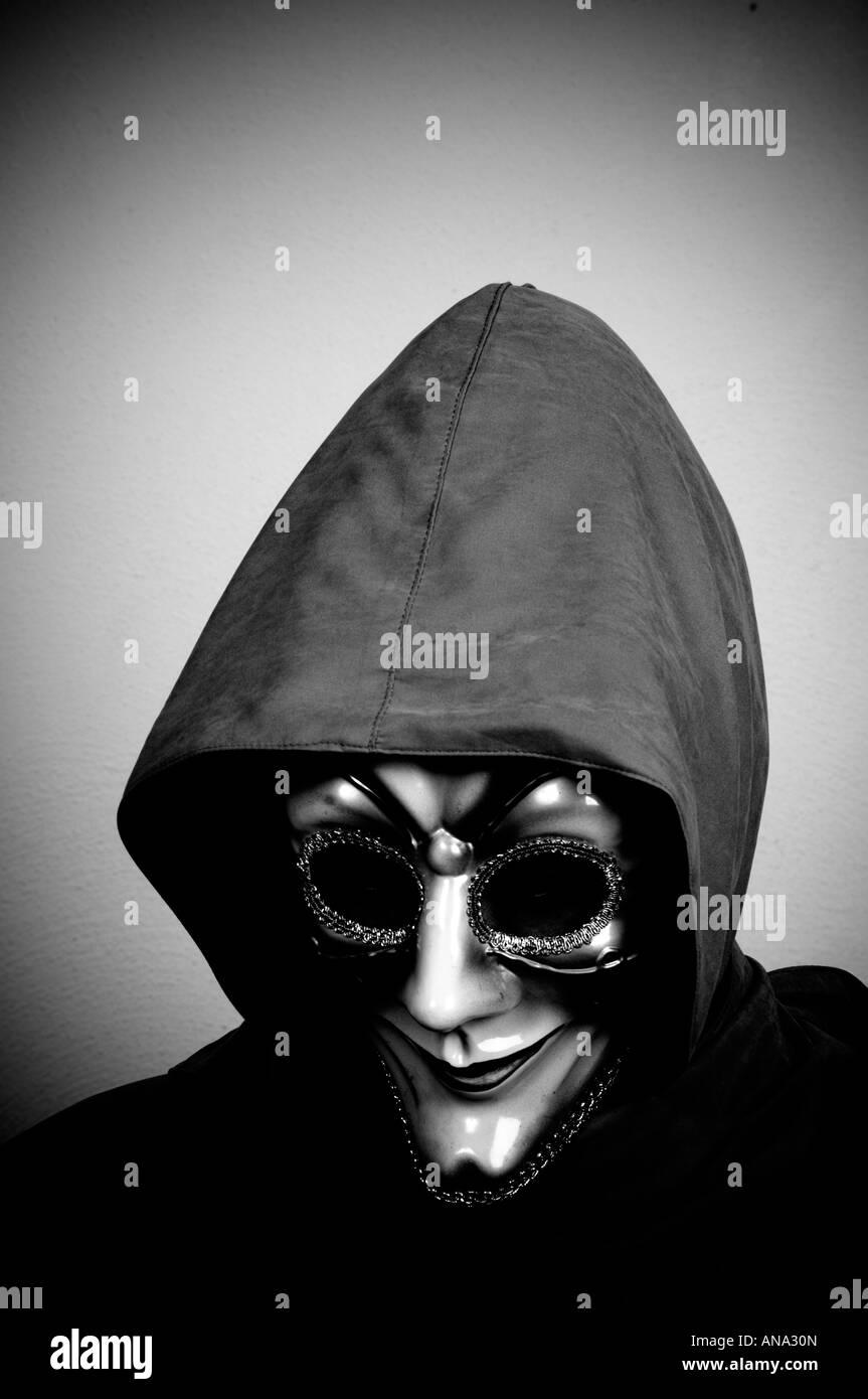 Person wearing Venetian mask - Stock Image