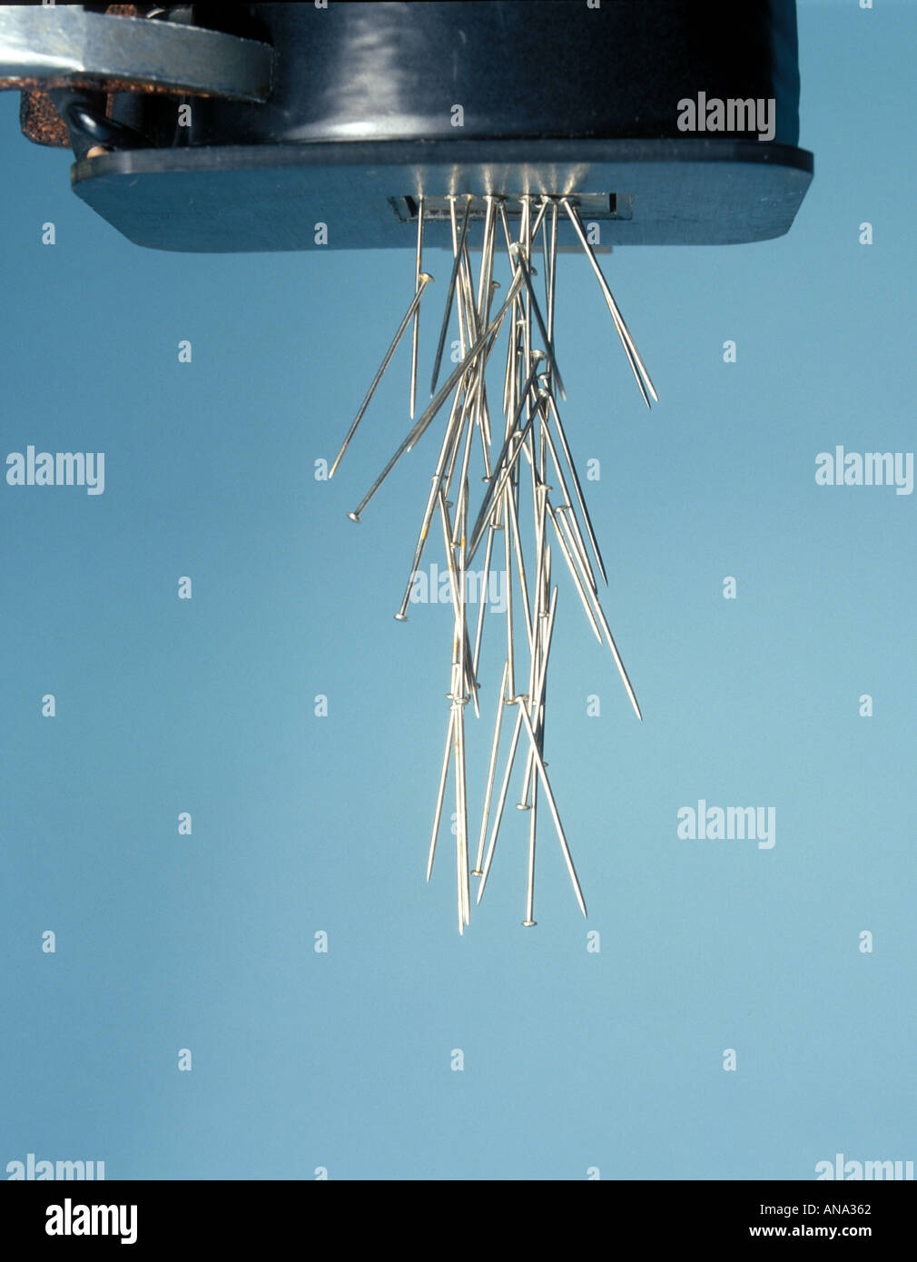 steel pins attracted to an electromagnet - Stock Image