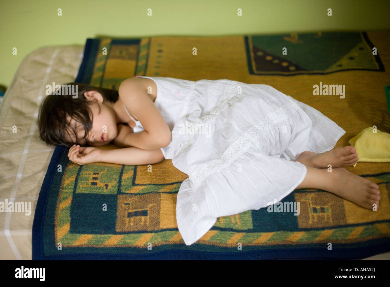 Child in white dress sleeping - Stock Image