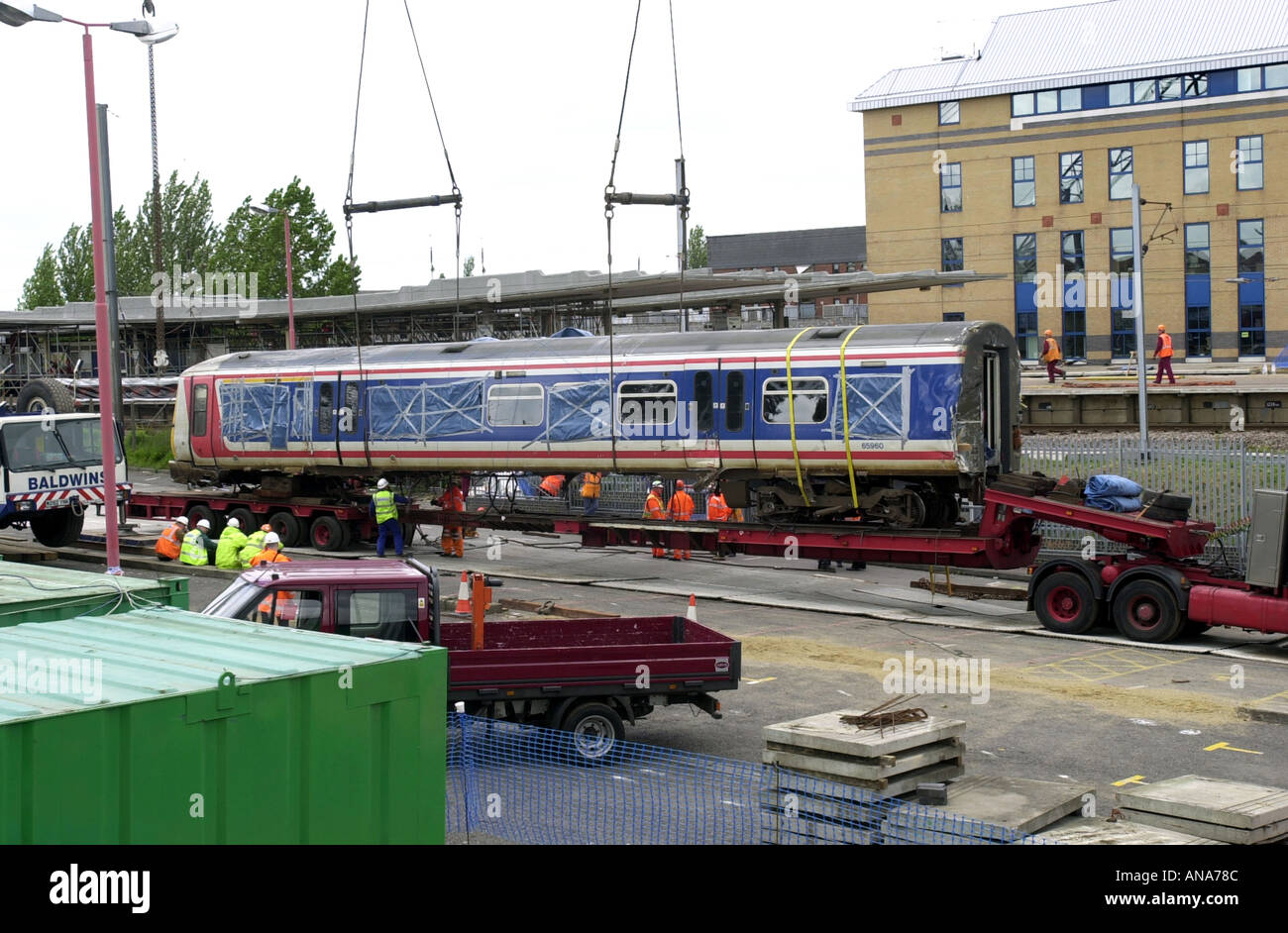 Carriage from the Potters Bar rail crash is lifted from the tracks UK - Stock Image