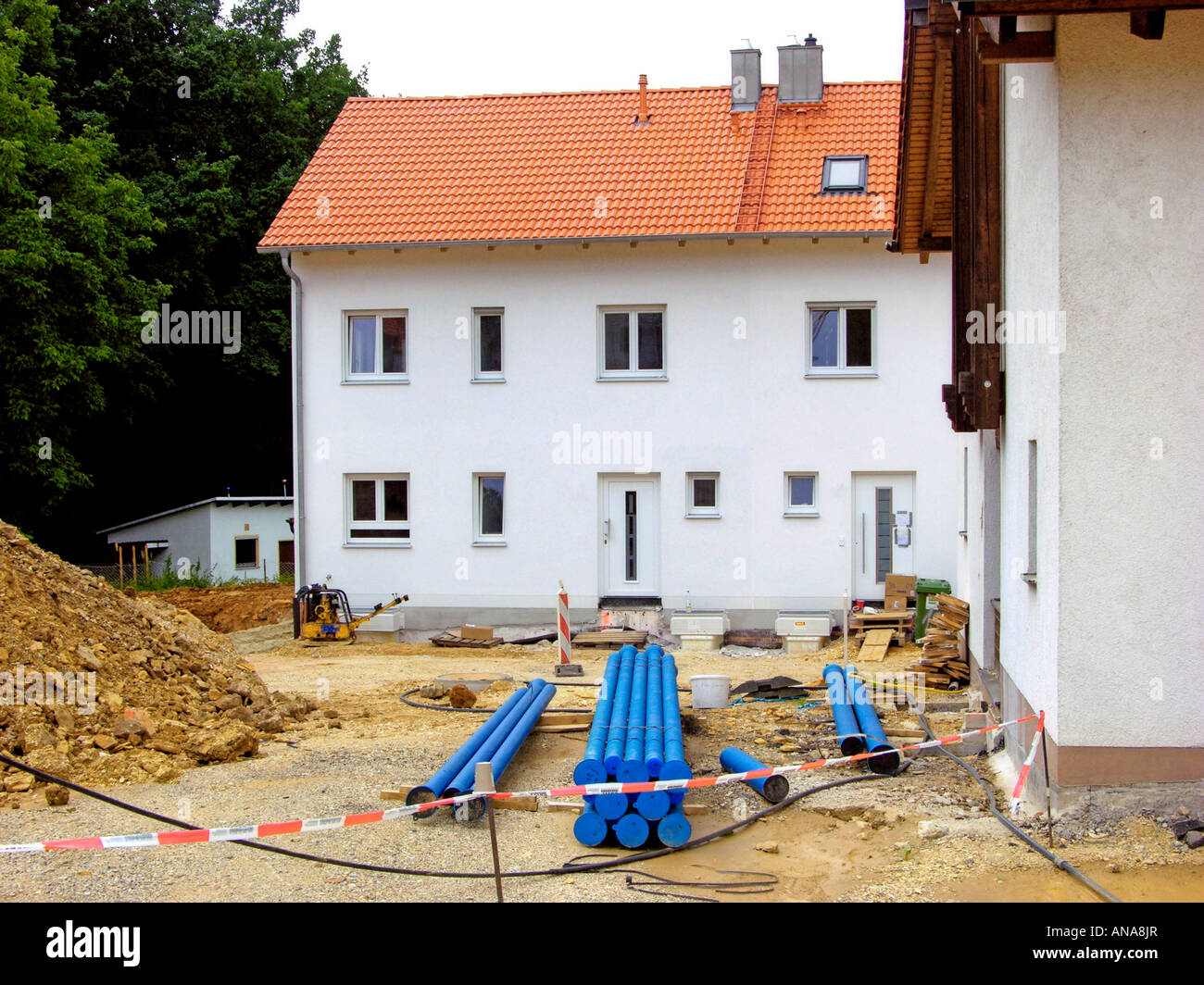 building site construction site site of works road works home family new modern terraced house town house row house - Stock Image