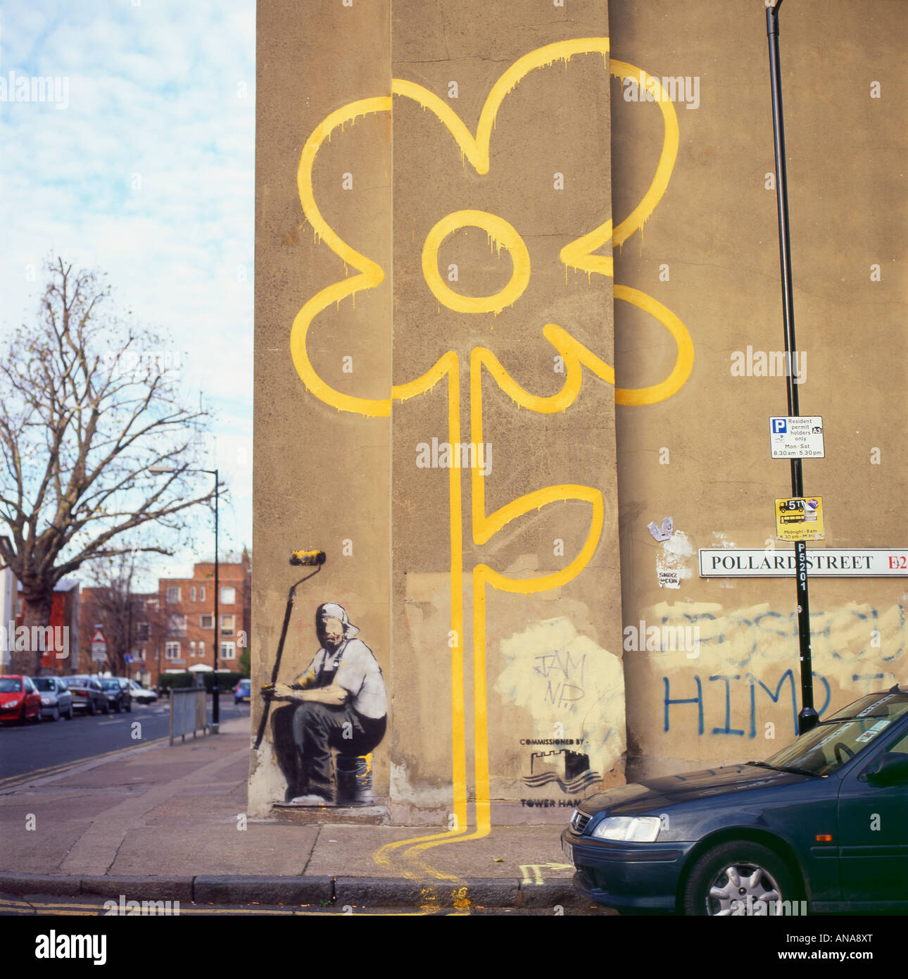 Banksy yellow line flower painting and painter holding a roller on a ...