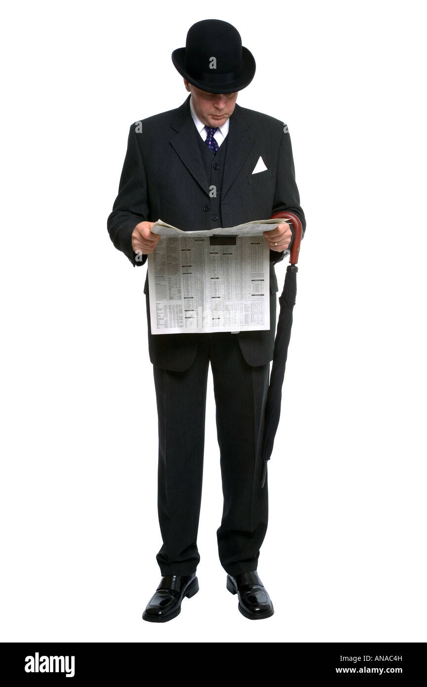 Businessman in bowler hat and three pice pinstripe suit reading a financial newspaper Stock Photo