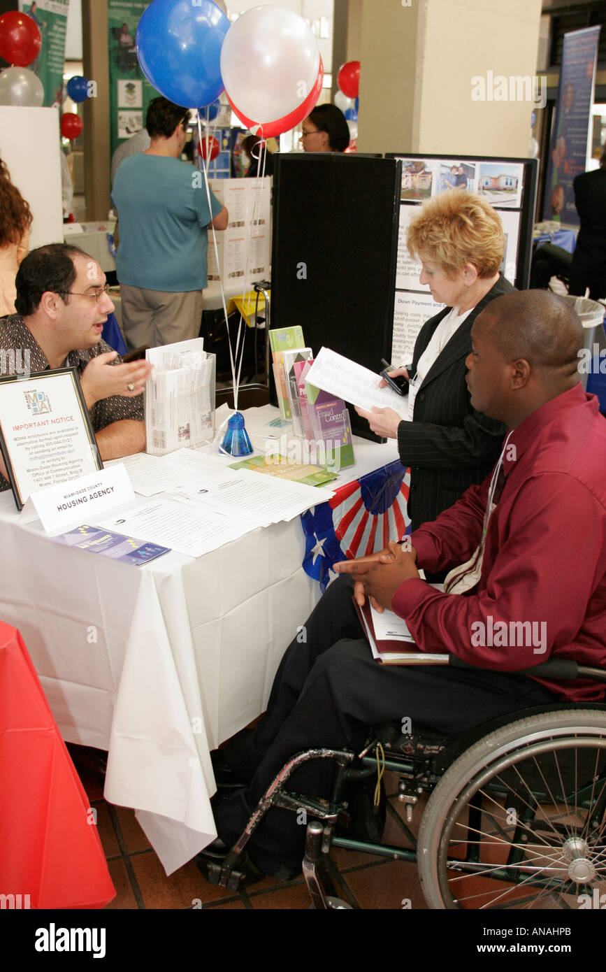 Miami Florida Disability Resource Fair nonprofit agencies housing Black male wheelchair - Stock Image