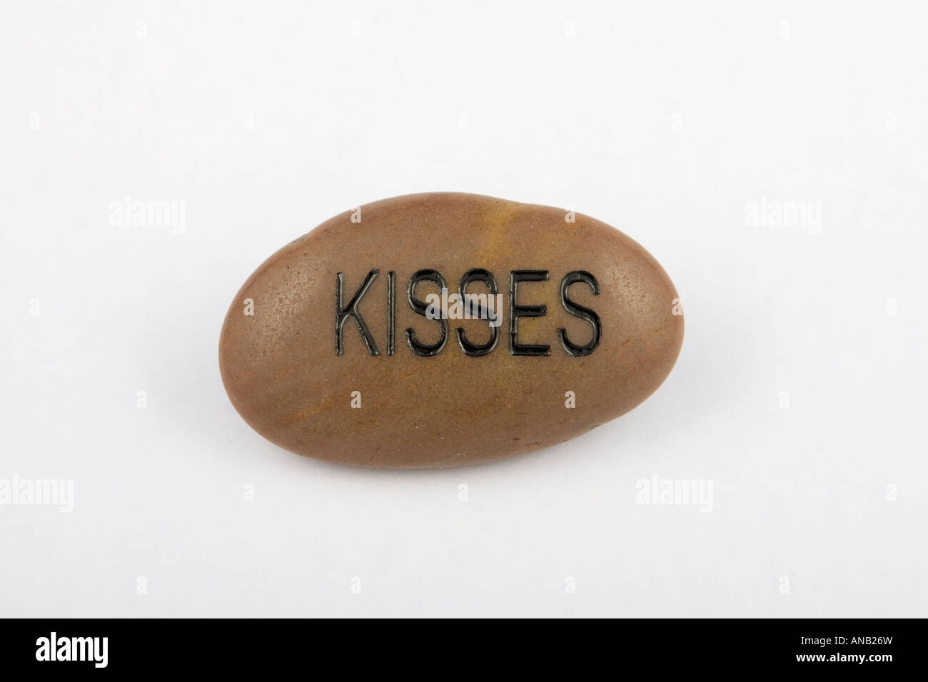 Word on stone: Kisses - Stock Image