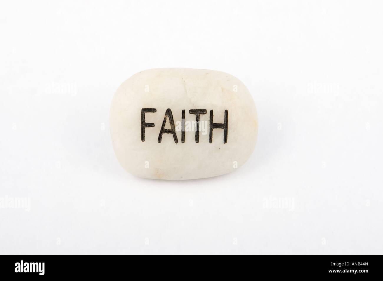 Word on stone: Faith - Stock Image