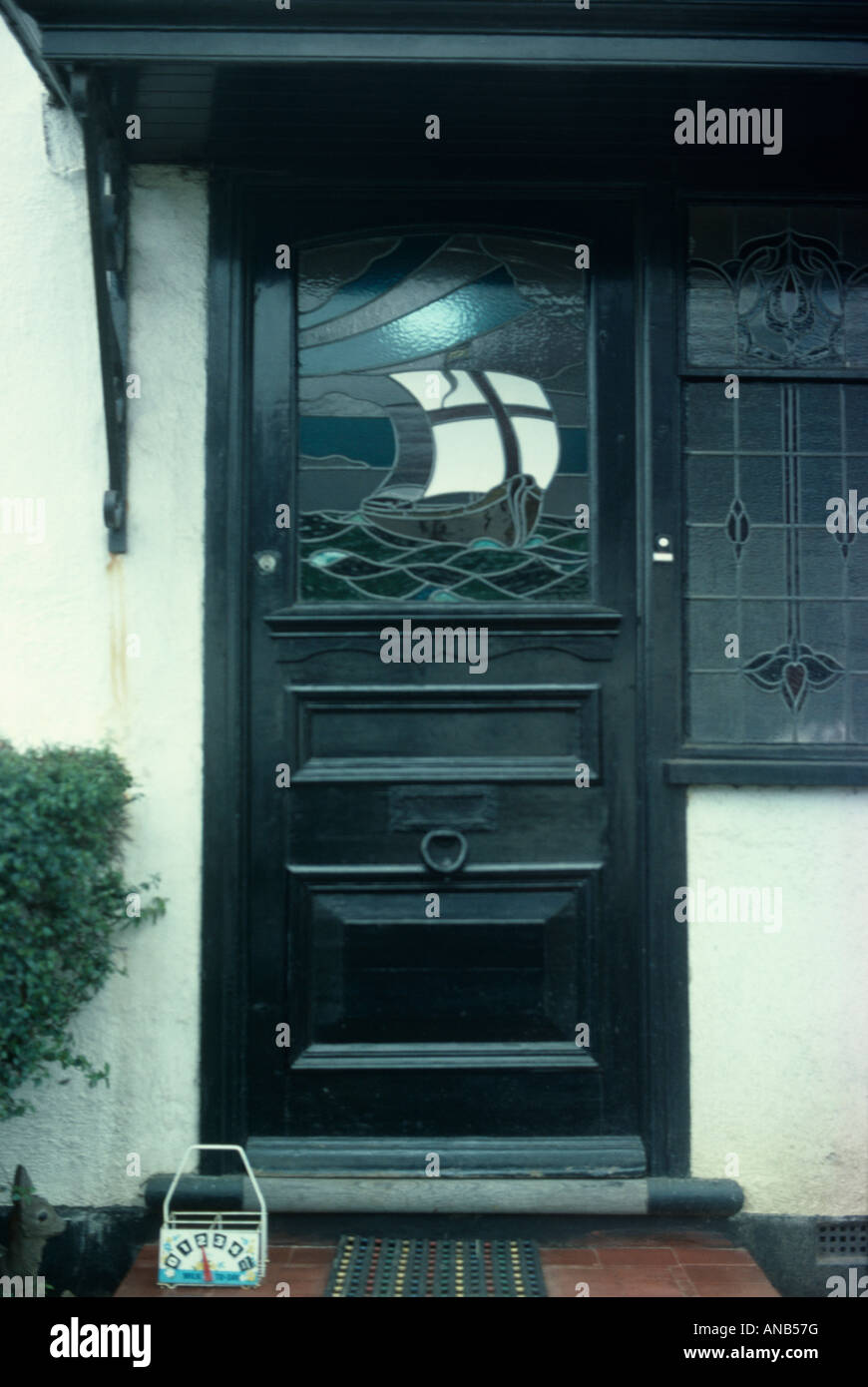 Stained Glass Window Of Sailing Ship In Black Front Door   Stock Image
