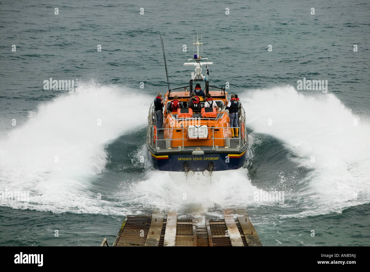 The Sennen lifeboat launches. - Stock Image