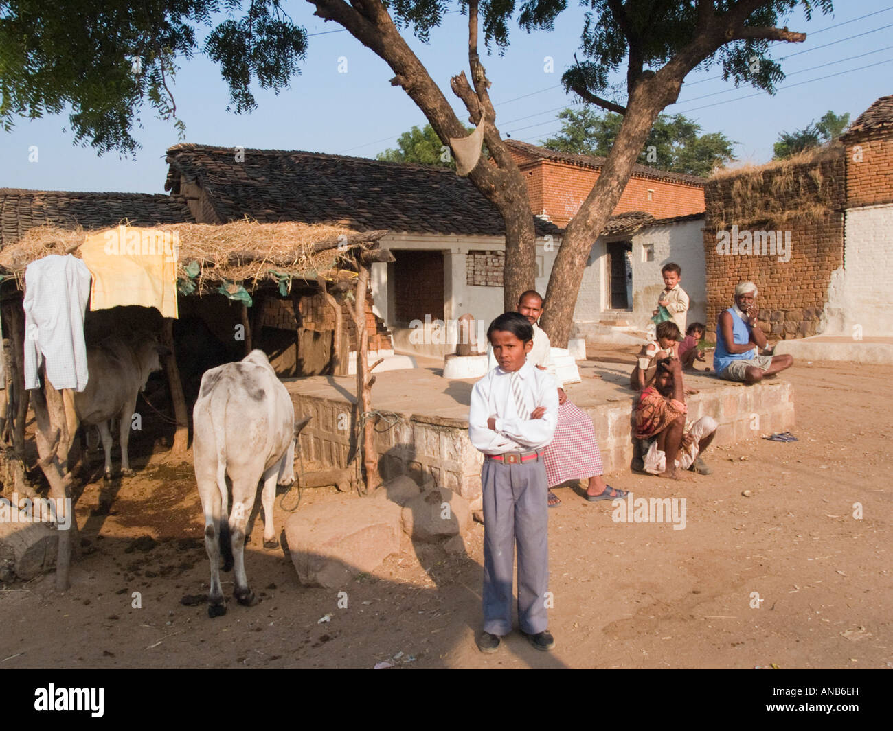 People with young boy standing in front outside typical for South indian home images