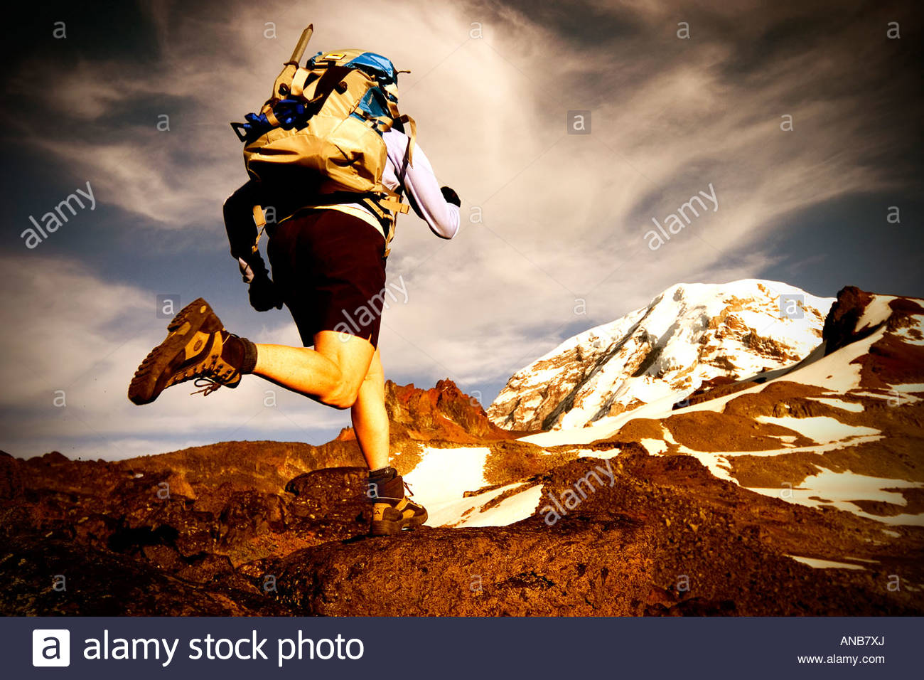Jane Matera rock hopping through Spray Park Mt Rainier National Park Washington - Stock Image