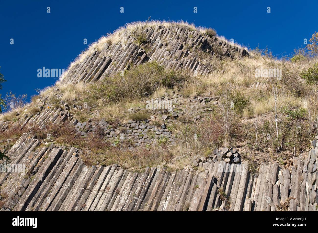 Basalt columns in the centre of Usson (Puy de Dôme - France). Orgue basaltique au centre du village d' - Stock Image