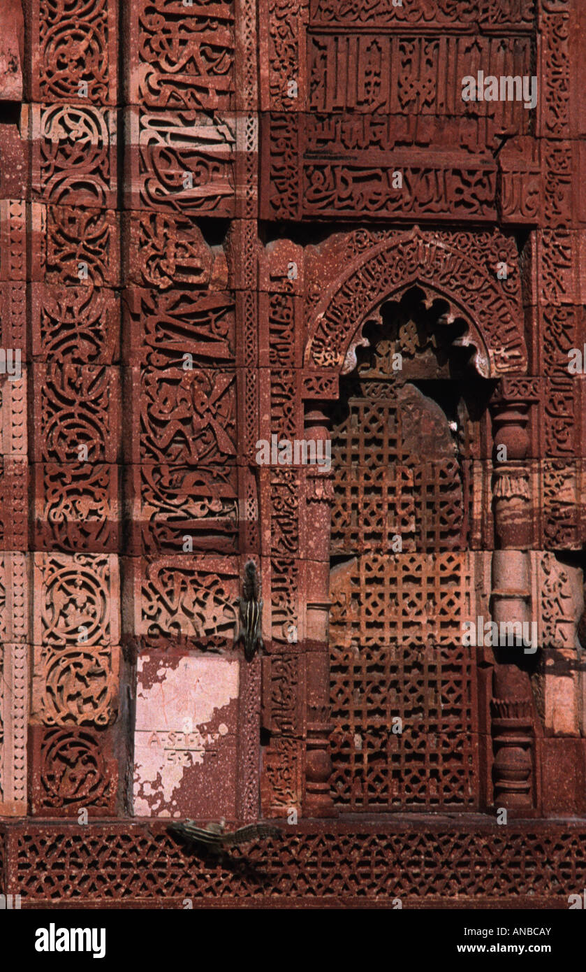 Squirrels running up the islamic architecture of the historical Qutb Minar complex New Delhi India - Stock Image