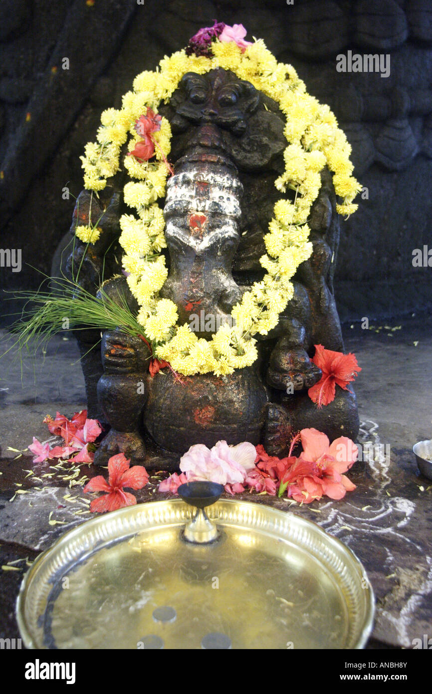 A garlanded statue of Ganesha in the Bull Temple in the Basavanagudi district of Bangalore. Ganesha is the god of - Stock Image