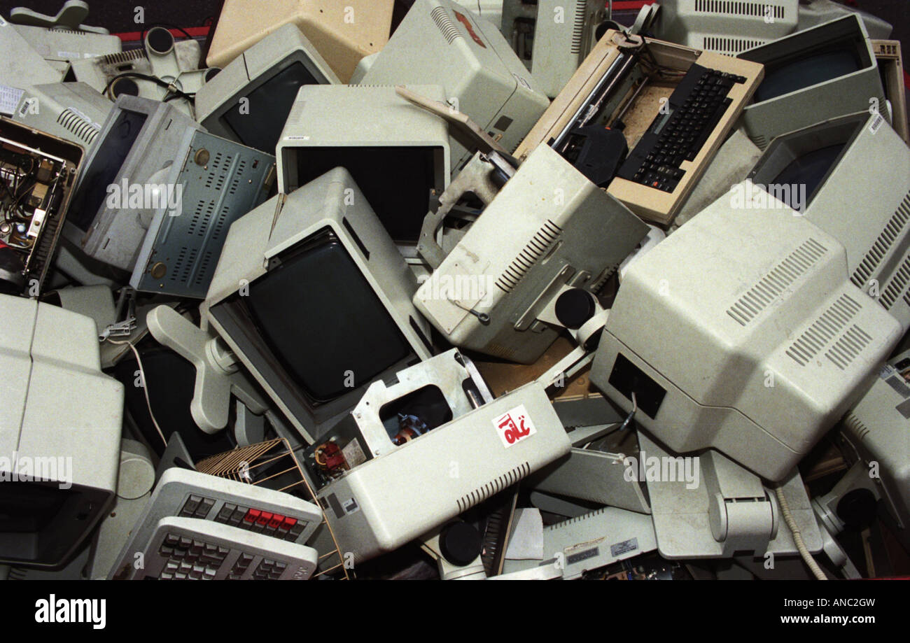 computers redundant rubbish technology outdated trash in dump skip - Stock Image