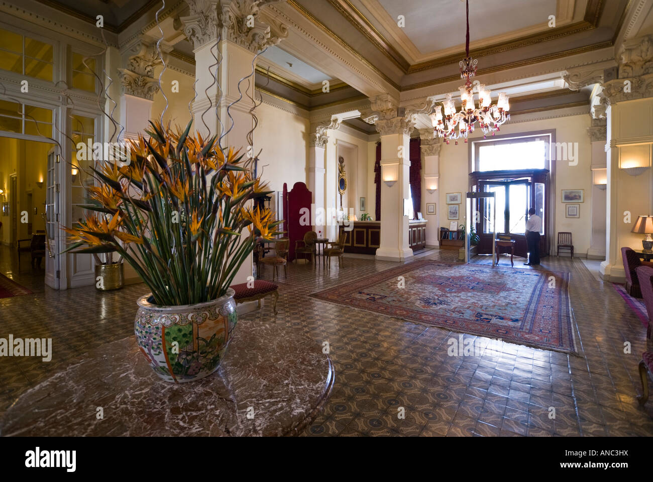 Hotel Entrance Foyer : Grand entrance hall with chandelier stock photos