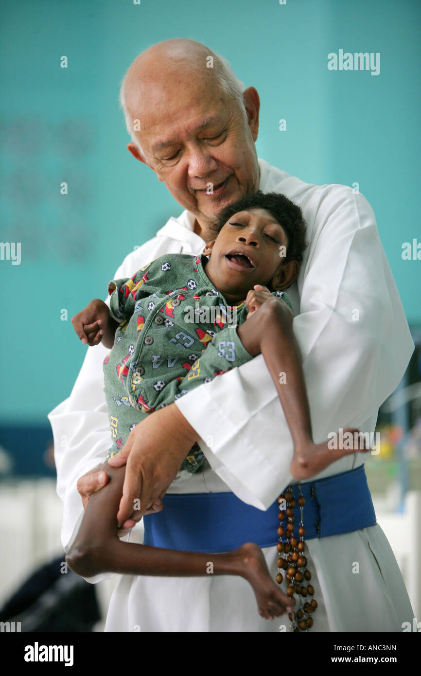Father Richard Ho Lung, founder and head of the roman catholic congrigation 'Missionaries of the Poor' with - Stock Image