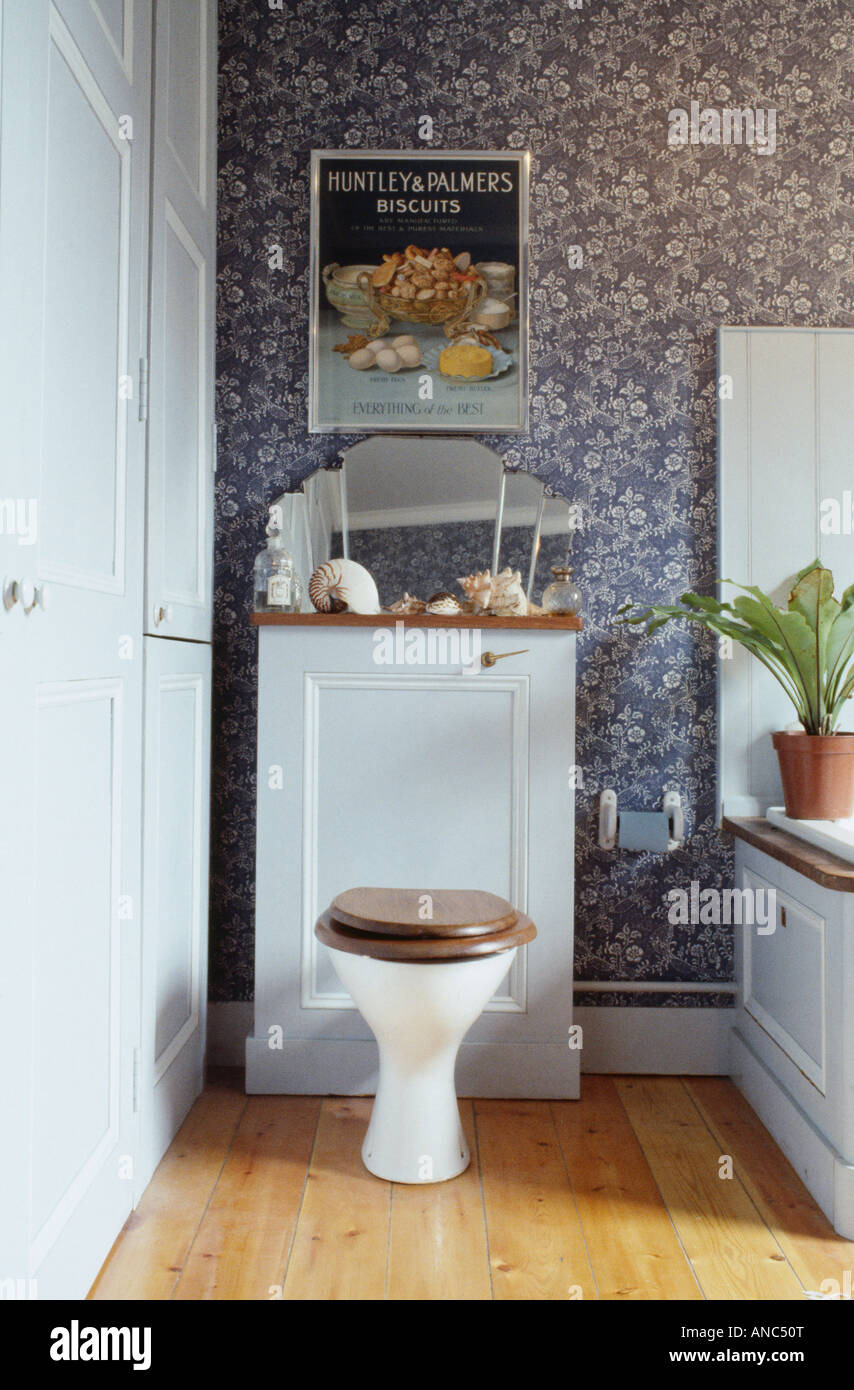 White toilet in seventies bathroom with patterned blue white Stock ...