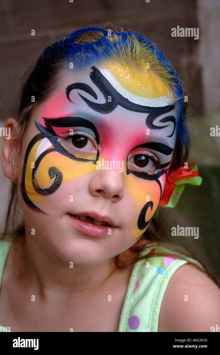 6 year old girl got her face painted at New Haven's annual Festival of Arts and Ideas. - Stock Image