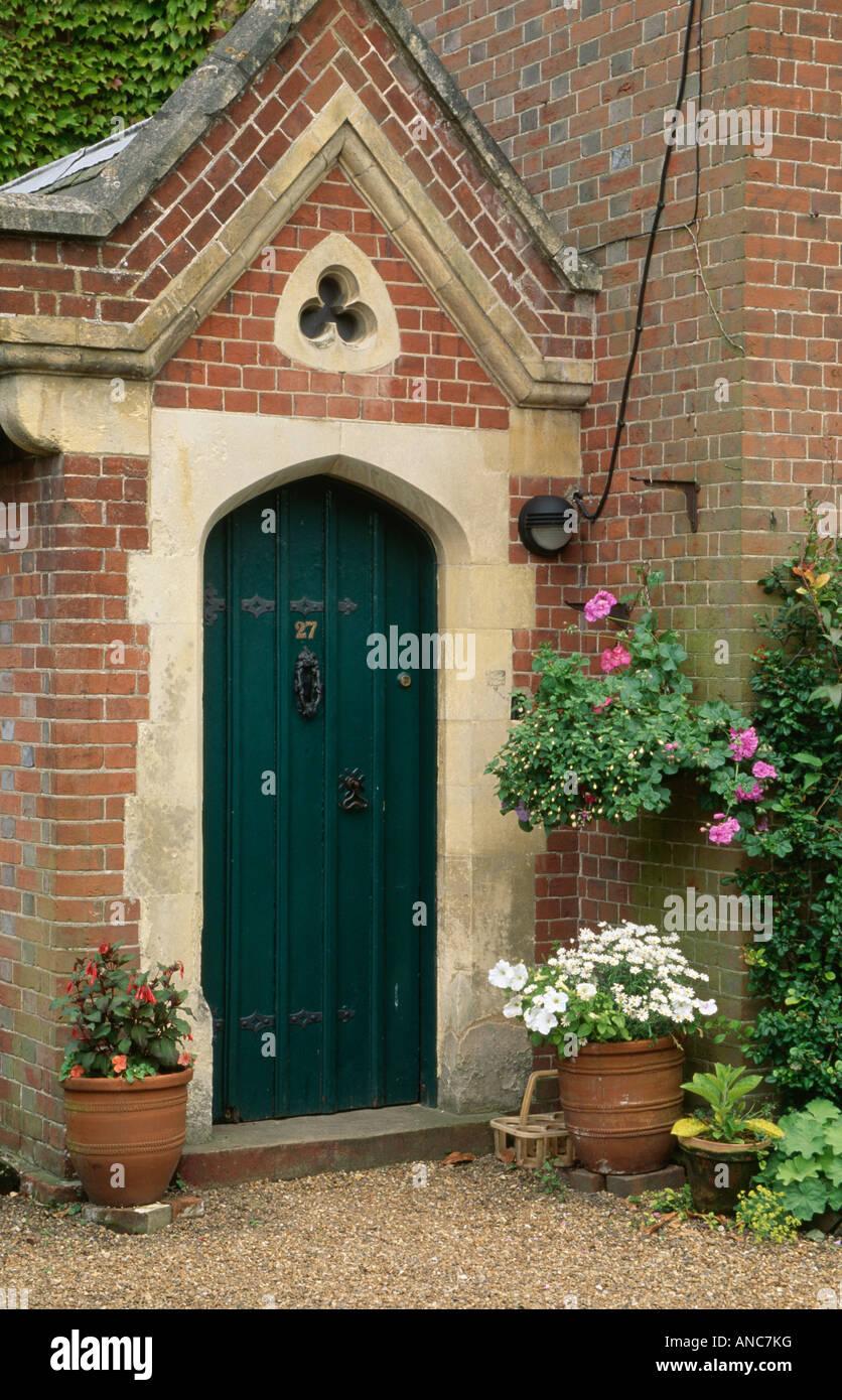 Summer Flowering Plants In Pots On Either Side Of Black Front Door