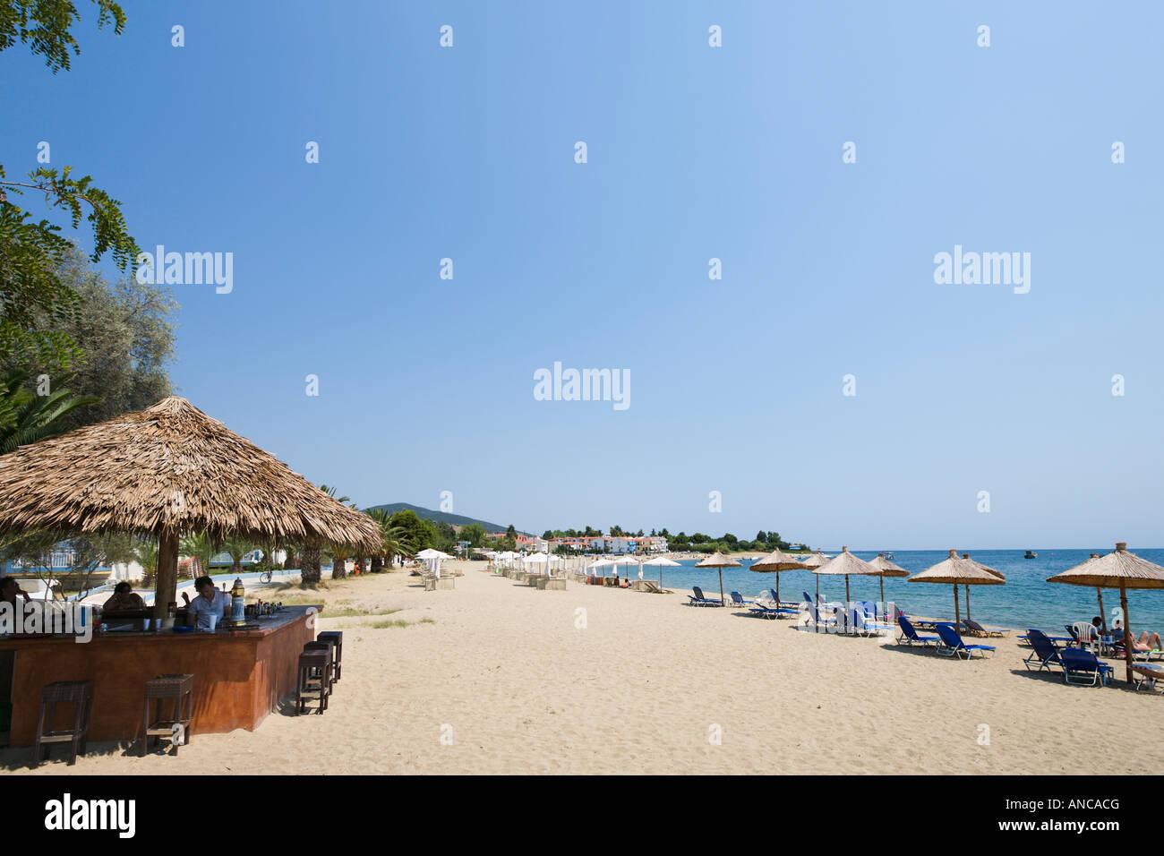 Beach and Beach Bar, Gerakina, Halkidiki, Greece - Stock Image