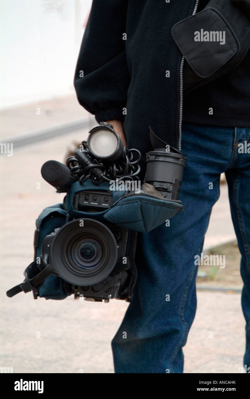 tv camera cameraman man television news crew - Stock Image