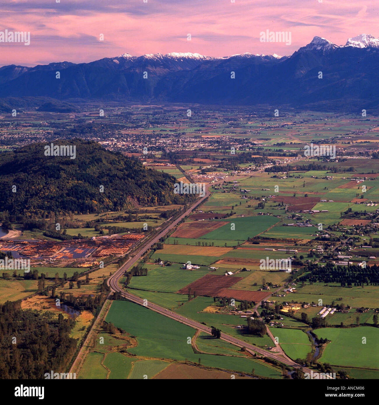 An Aerial View of the Trans Canada Highway 1 running through the Fraser Valley in British Columbia Canada - Stock Image