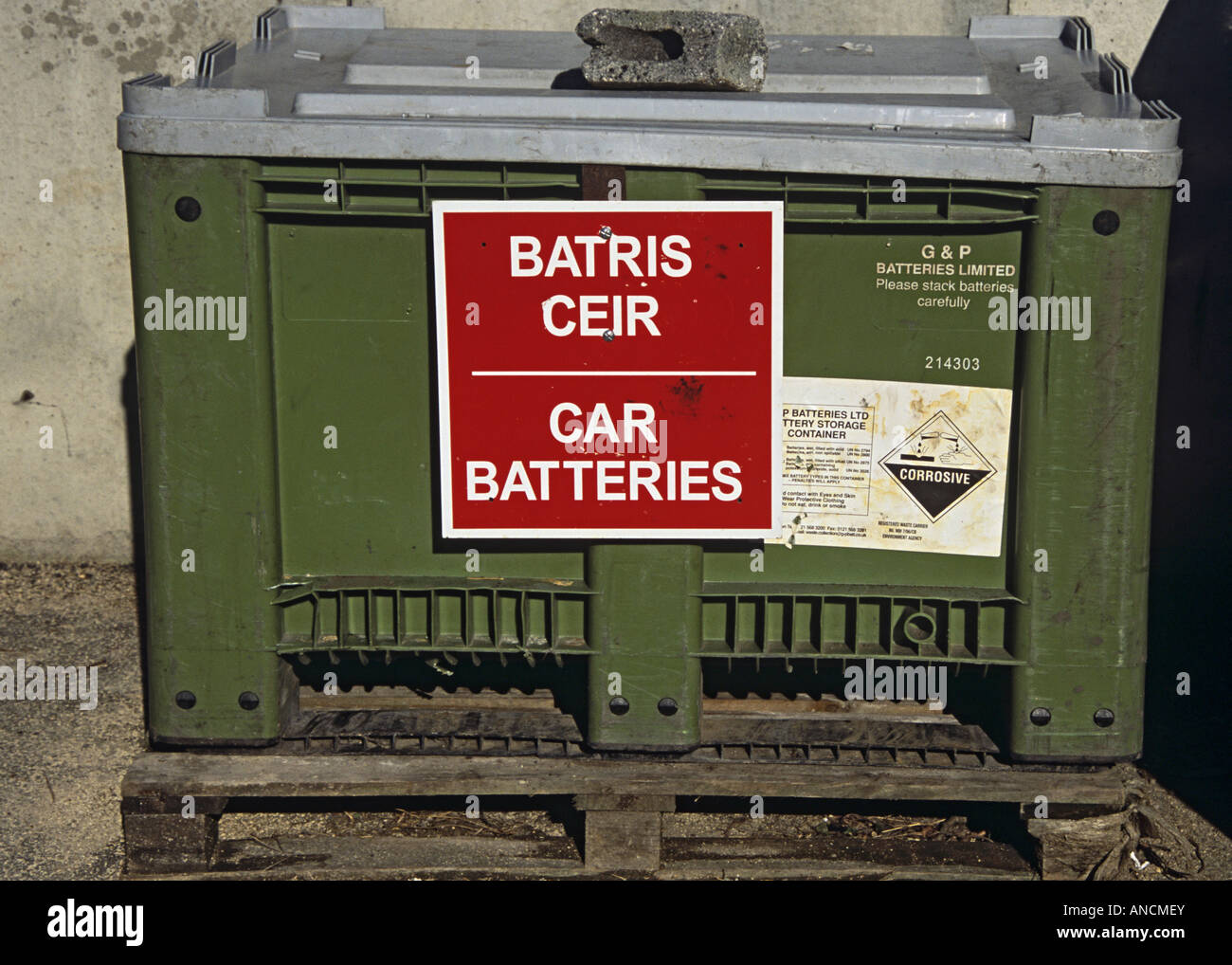 North Wales UK A green plastic skip for safe disposal of unwanted or dead car batteries at the local council tip Stock Photo