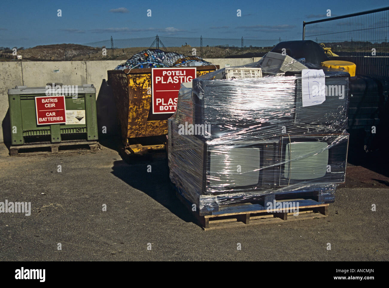 North Wales UK A pallet full of broken and unwanted television screens computer monitors and hard drives ready for - Stock Image