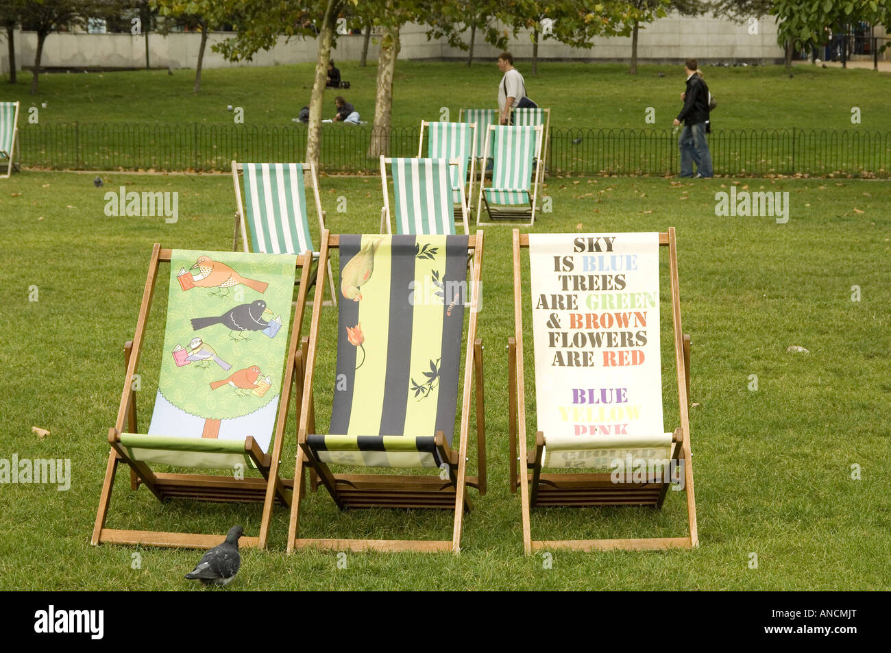 Stylised deck chairs in Green Park London - Stock Image