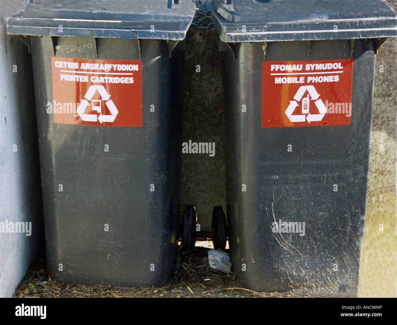 North Wales UK Two black wheelies bins for the safe disposal of unwanted mobile phones and empty printer cartridges Stock Photo