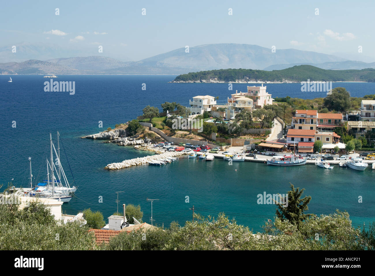 View over the town and harbour of Kassiopi from nearby Byzantine fortress. Corfu island, Greece. - Stock Image