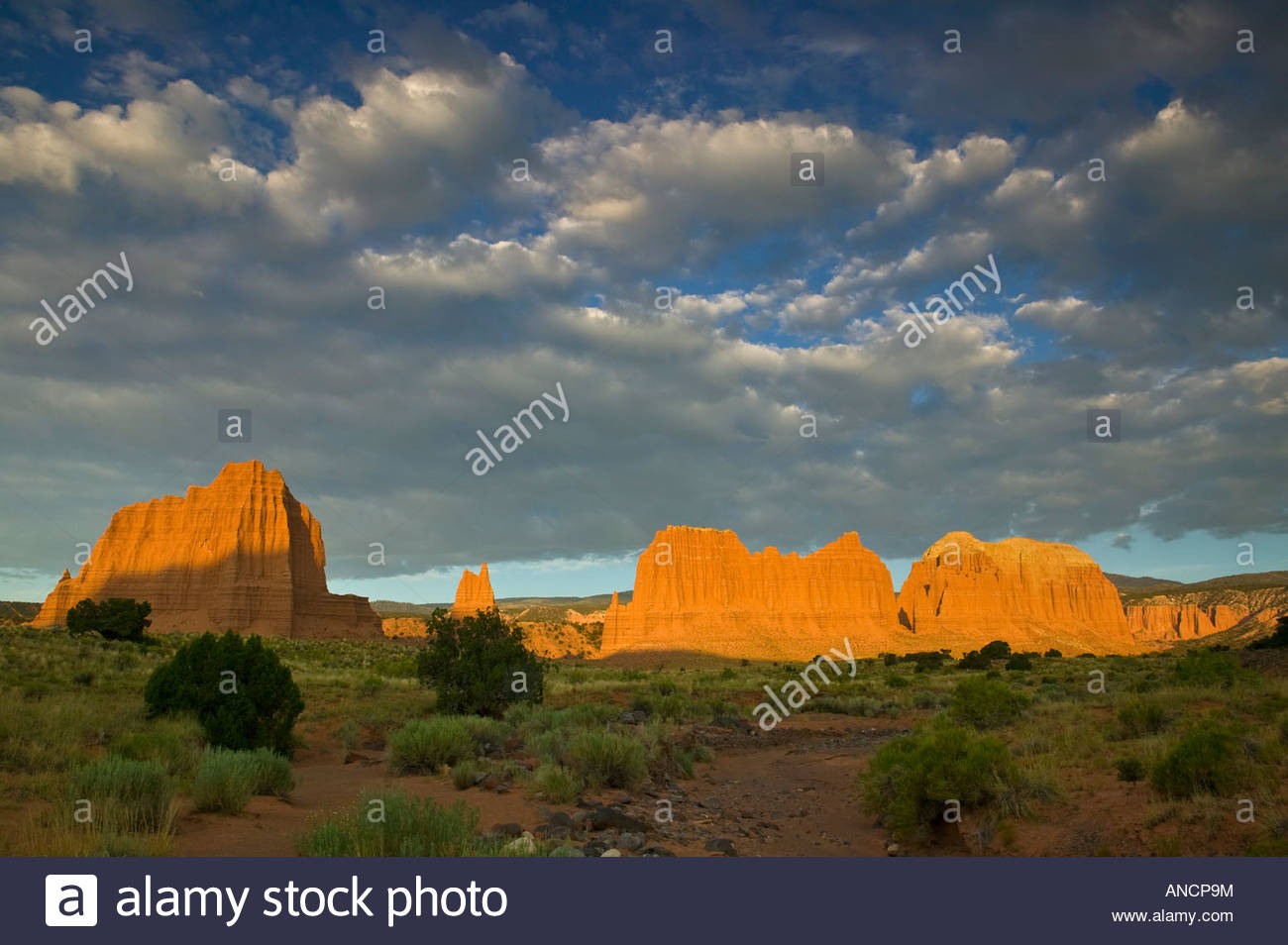 Several prominent monoliths in the Cathedral Valley of Capitol Reef National Park, Utah, are turned shades of red - Stock Image