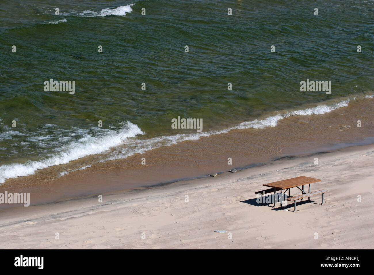 Empty Sandy Beach On Lake Michigan With Wooden Picnic Table Nobody - Picnic table michigan