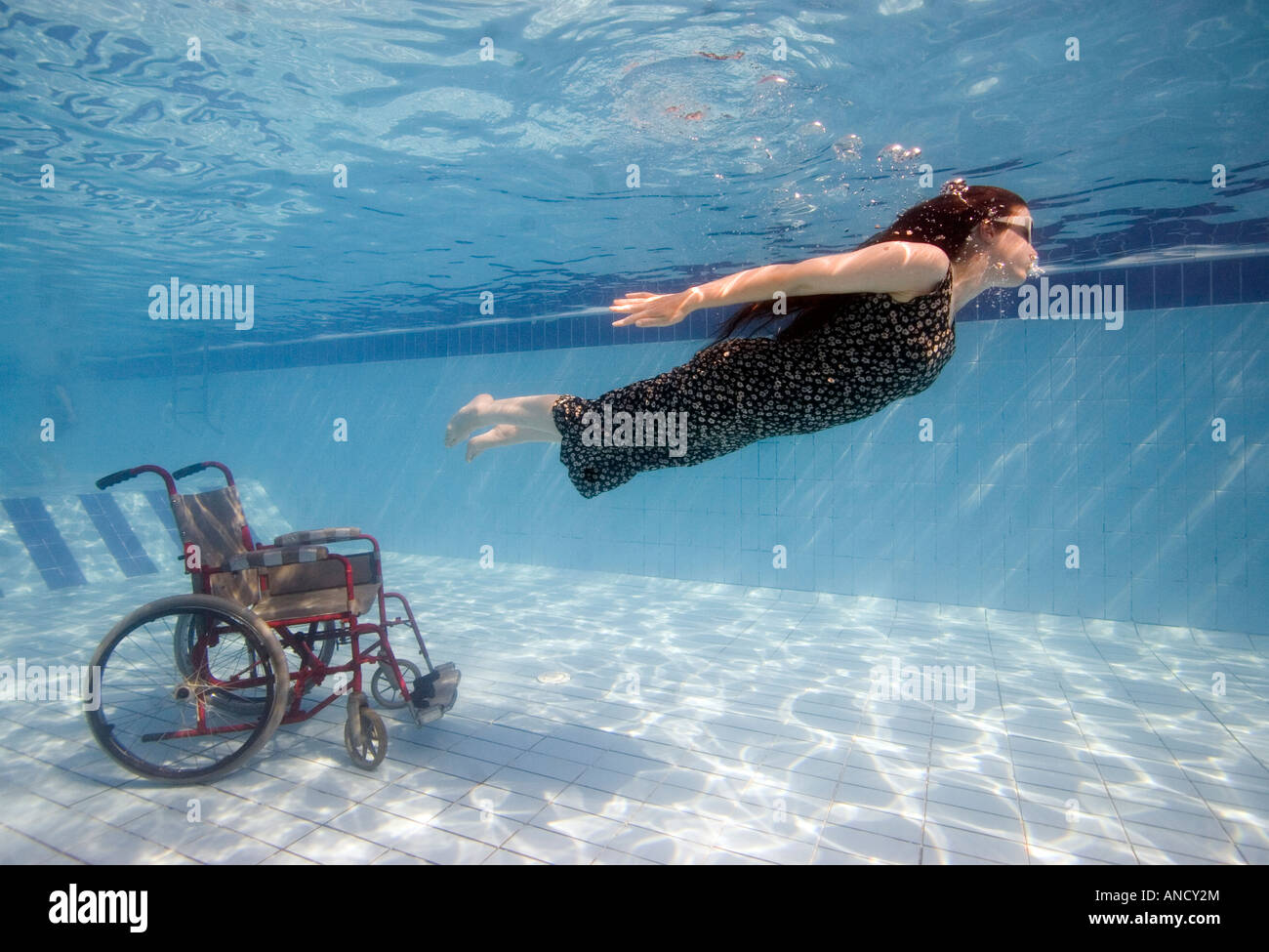 A disabled diver breaks free from her wheel chair in - Swimming pool wheelchair lift law ...