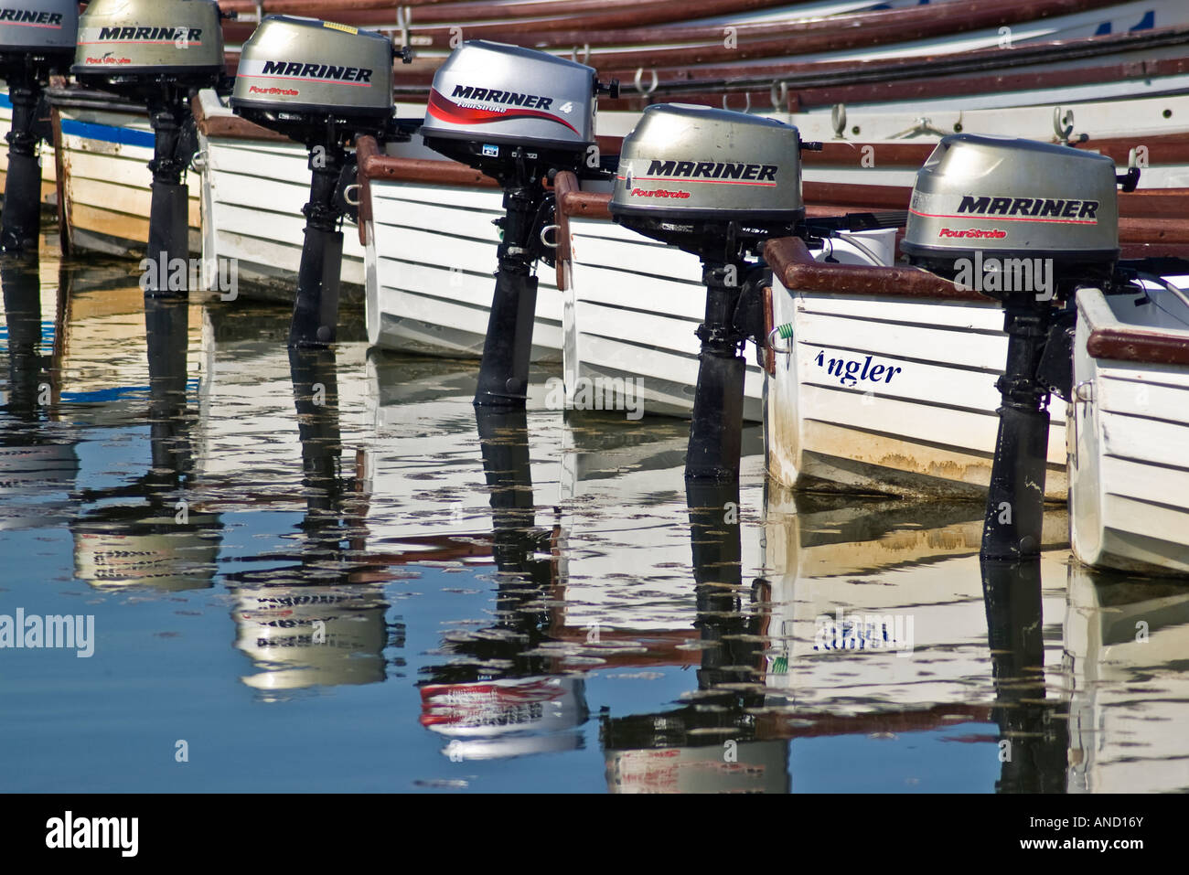 Outboard motors on dinghies - Stock Image