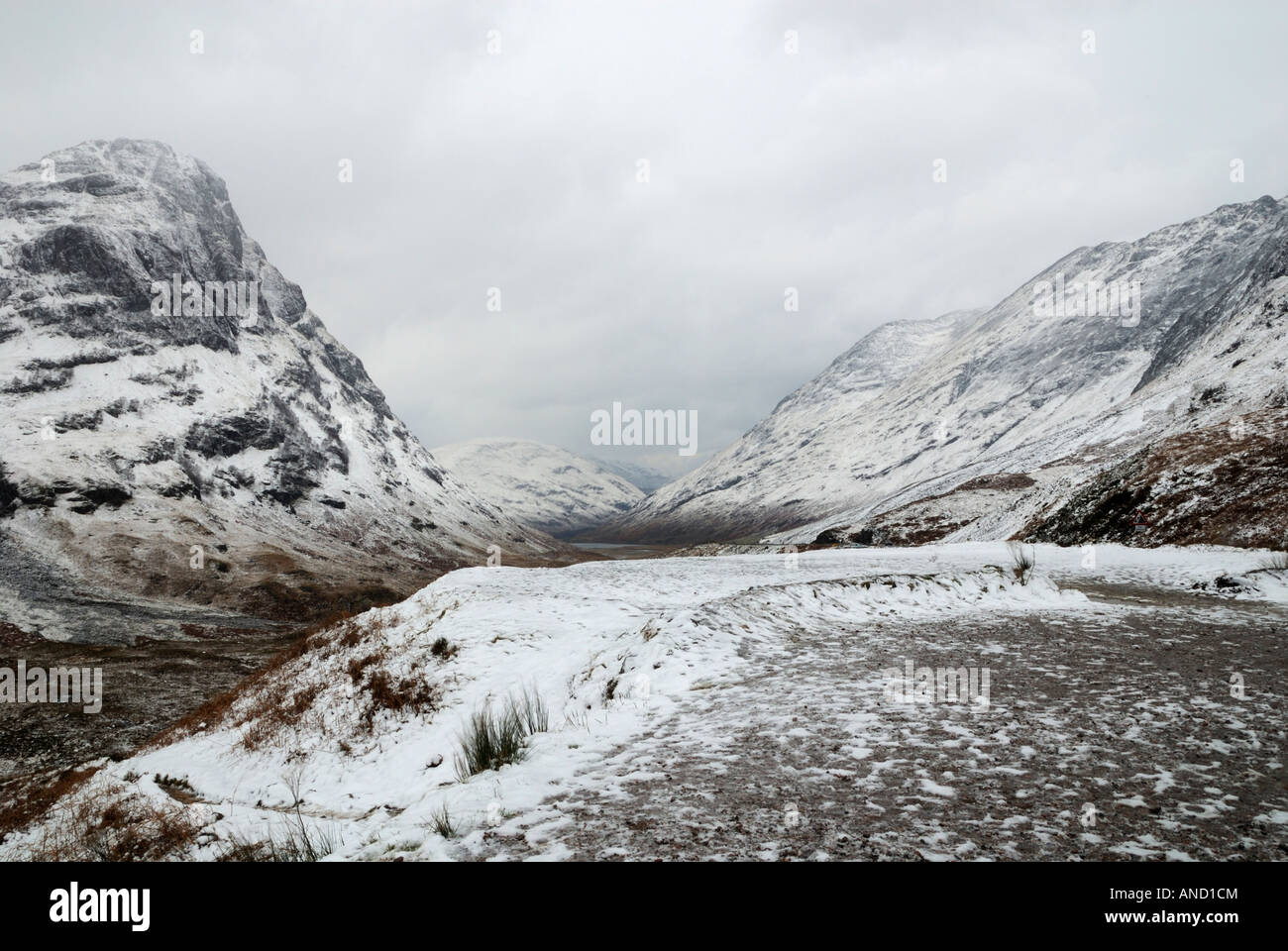 Glencoe in the depths of winter with a snowstorm in progress. - Stock Image