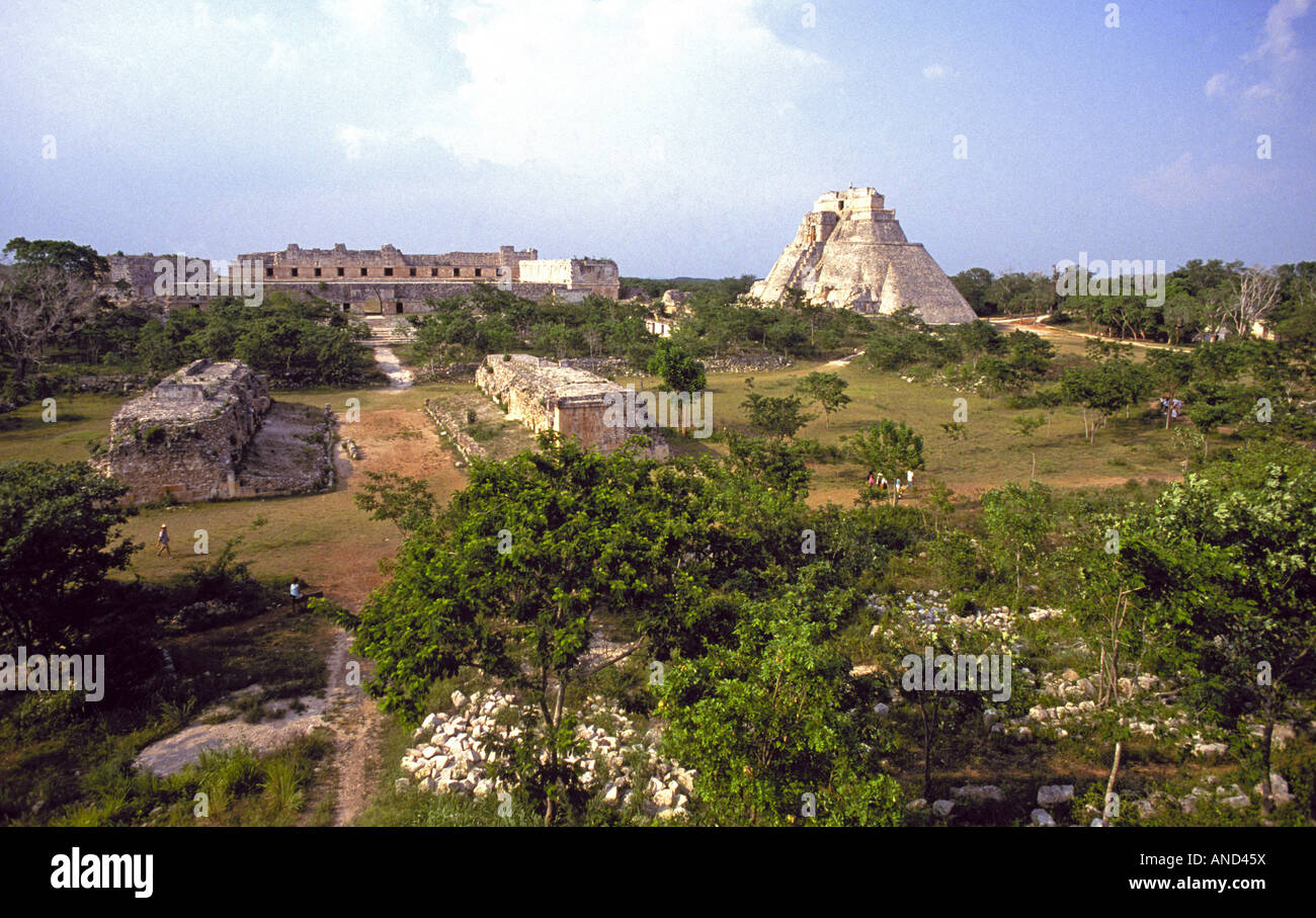 The main stone pyramid and other structures of the ruined Mayan city of Uxmal near Merida - Stock Image
