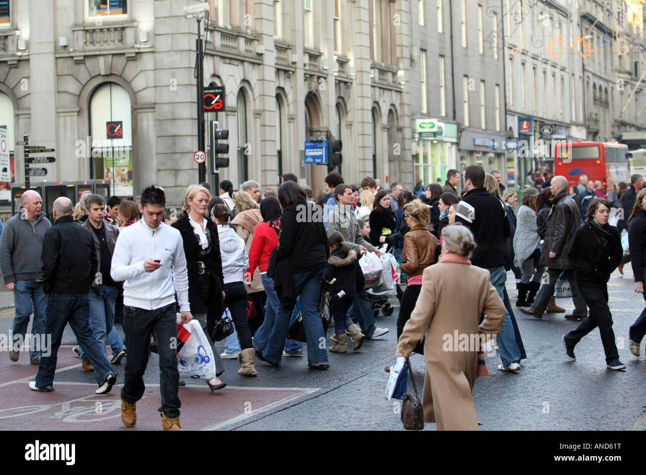 Shoppers in Union Street in the middle of a bustling and busy Aberdeen city centre, Scotland, UK - Stock Image