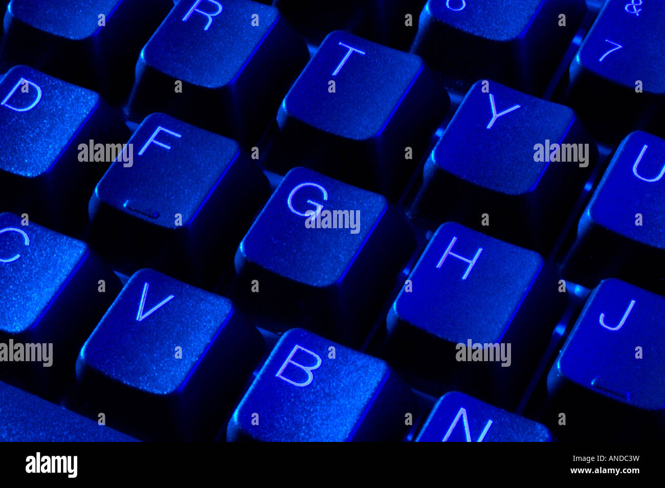 Blue computer keyboard with alphanumerical qwerty keys - Stock Image