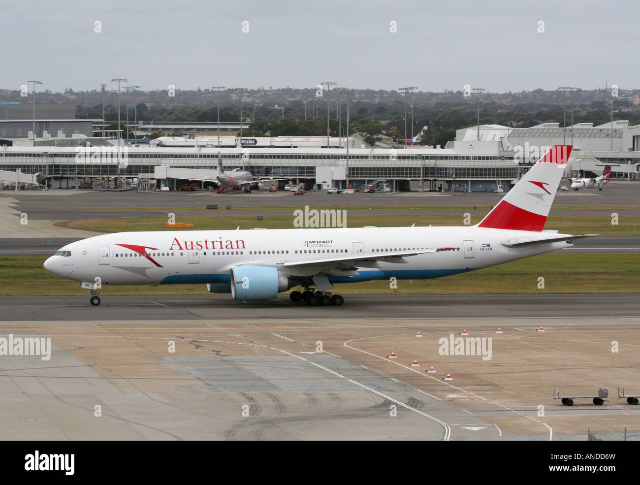 Long haul air travel. Austrian Airlines Boeing 777-200ER widebody passenger jet plane taxiing at Sydney Airport, - Stock Image