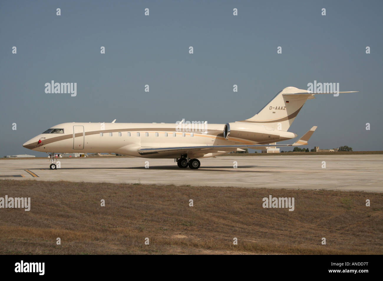Bombardier Global Express large business jet parked on the ground. - Stock Image
