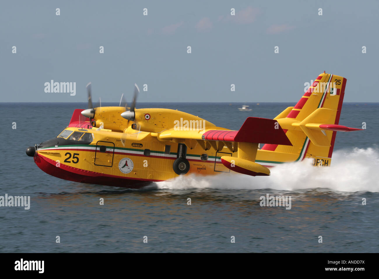 An Italian Bombardier 415 (Canadair CL-415) waterbomber seaplane skimming the sea - Stock Image