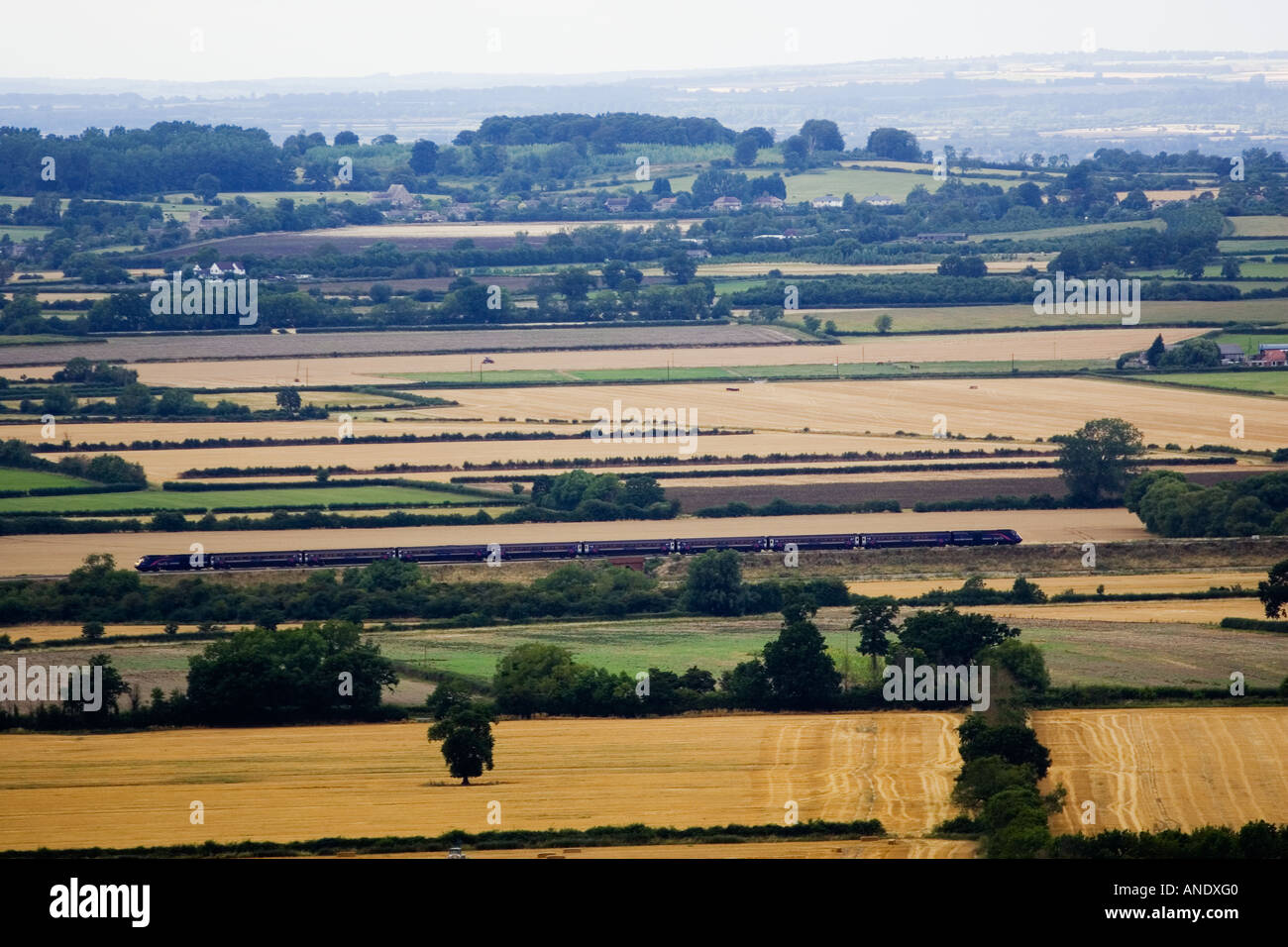 Train travels through Cotswolds countryside Oxfordshire United Kingdom - Stock Image
