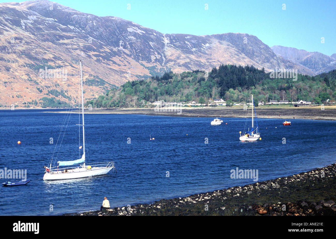 Sailing boats anchored in Loch Leven near Glencoe in western Highland Scotland Stock Photo