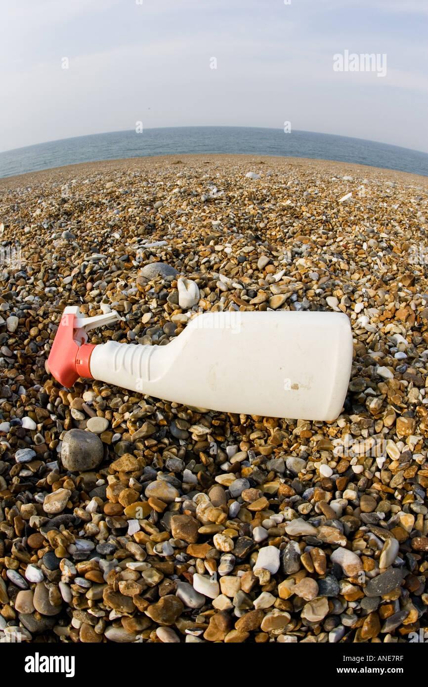 Plastic spray bottle discarded on Cley Beach Norfolk United Kingdom Stock Photo